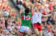 11 September 2021; Cathal McShane of Tyrone, right, beats Oisín Mullin of Mayo to the ball to score his side's first goal during the GAA Football All-Ireland Senior Championship Final match between Mayo and Tyrone at Croke Park in Dublin. Photo by Brendan Moran/Sportsfile
