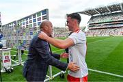 11 September 2021; Former Tyrone captain and Sky Sports GAA pundit Peter Canavan celebrates with son Darragh Canavan of Tyrone after the GAA Football All-Ireland Senior Championship Final match between Mayo and Tyrone at Croke Park in Dublin. Photo by Brendan Moran/Sportsfile