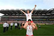 11 September 2021; Tiernan McCann of Tyrone carries team-mate Conor Meyler following victory in the GAA Football All-Ireland Senior Championship Final match between Mayo and Tyrone at Croke Park in Dublin. Photo by Ramsey Cardy/Sportsfile