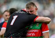 11 September 2021; Ryan O'Donoghue of Mayo, right, is consoled by team-mate Rob Hennelly during the GAA Football All-Ireland Senior Championship Final match between Mayo and Tyrone at Croke Park in Dublin. Photo by Brendan Moran/Sportsfile