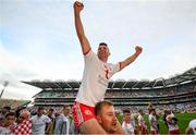 11 September 2021; Darren McCurry of Tyrone celebrates on the shoulders of team-mate Michael O'Neill after the GAA Football All-Ireland Senior Championship Final match between Mayo and Tyrone at Croke Park in Dublin. Photo by Stephen McCarthy/Sportsfile