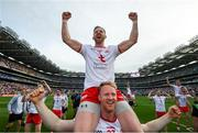 11 September 2021; Frank Burns of Tyrone celebrates on the shoulders of team-mate Hugh Pat McGeary after the GAA Football All-Ireland Senior Championship Final match between Mayo and Tyrone at Croke Park in Dublin. Photo by Stephen McCarthy/Sportsfile