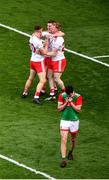 11 September 2021; Tyrone players, left to right, Niall Kelly, Peter Harte, and Hugh Pat McGeary celebrate, as Diarmuid O'Connor of Mayo leaves the field after the GAA Football All-Ireland Senior Championship Final match between Mayo and Tyrone at Croke Park in Dublin. Photo by Daire Brennan/Sportsfile