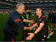 11 September 2021; Mayo manager James Horan congratulates Tyrone joint-manager Brian Dooher after the GAA Football All-Ireland Senior Championship Final match between Mayo and Tyrone at Croke Park in Dublin. Photo by Stephen McCarthy/Sportsfile