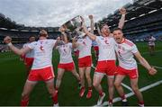11 September 2021; Tyrone players, from left, Ronan McNamee, Cathal McShane, Frank Burns and Niall Kelly celebrate with the Sam Maguire Cup after the GAA Football All-Ireland Senior Championship Final match between Mayo and Tyrone at Croke Park in Dublin. Photo by Ramsey Cardy/Sportsfile