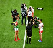 11 September 2021; Referee Joe McQuillan tosses the coin with captains Aidan O'Shea of Mayo and Pádraig Hampsey of Tyrone ahead of the GAA Football All-Ireland Senior Championship Final match between Mayo and Tyrone at Croke Park in Dublin. Photo by Daire Brennan/Sportsfile