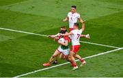 11 September 2021; Pádraig O'Hora of Mayo is fouled by Peter Harte, left, and Kieran McGeary of Tyrone, which referee Joe McQuillan awarded a 13m free for during the GAA Football All-Ireland Senior Championship Final match between Mayo and Tyrone at Croke Park in Dublin. Photo by Daire Brennan/Sportsfile