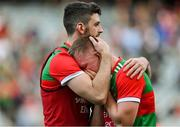 11 September 2021; Ryan O'Donoghue of Mayo is consoled by team-mate Brendan Harrison after the GAA Football All-Ireland Senior Championship Final match between Mayo and Tyrone at Croke Park in Dublin. Photo by Brendan Moran/Sportsfile