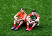 11 September 2021; Mayo selector Ciarán McDonald, left, and Jordan Flynn sit on the field after the GAA Football All-Ireland Senior Championship Final match between Mayo and Tyrone at Croke Park in Dublin. Photo by Daire Brennan/Sportsfile