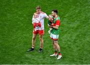 11 September 2021; Peter Harte of Tyrone, holding his ten month old daughter Ava, with Kevin McLoughlin of Mayo and his nine month old daughter Saorla, after the GAA Football All-Ireland Senior Championship Final match between Mayo and Tyrone at Croke Park in Dublin. Photo by Daire Brennan/Sportsfile