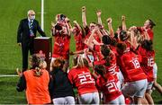 11 September 2021; Munster captain Sarah Quin lifts the trophy with team-mates after the Vodafone Women's Interprovincial Championship Round 3 match between Leinster and Munster at Energia Park in Dublin. Photo by Harry Murphy/Sportsfile
