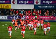 11 September 2021; Munster players run to their supporters after the Vodafone Women's Interprovincial Championship Round 3 match between Leinster and Munster at Energia Park in Dublin. Photo by Harry Murphy/Sportsfile