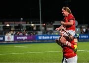 11 September 2021; Kate Sheehan of Munster celebrates with team-mate Nicole Cronin on her shoulders after the Vodafone Women's Interprovincial Championship Round 3 match between Leinster and Munster at Energia Park in Dublin. Photo by Harry Murphy/Sportsfile