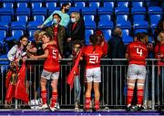 11 September 2021; Munster players, from left, Clodagh O'Halloran, Gemma Lane and Siobhán McCarthy celebrate with supporters after the Vodafone Women's Interprovincial Championship Round 3 match between Leinster and Munster at Energia Park in Dublin. Photo by Harry Murphy/Sportsfile