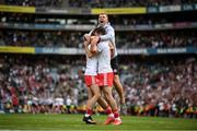 11 September 2021; Tyrone players Darren McCurry, left, Conor McKenna, right, and Michael Conroy, behind, celebrate following the final whistle of the GAA Football All-Ireland Senior Championship Final match between Mayo and Tyrone at Croke Park in Dublin. Photo by Stephen McCarthy/Sportsfile