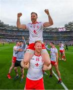 11 September 2021; Frank Burns is held aloft in celebration by his Tyrone team-mate Hugh Pat McGeary following the GAA Football All-Ireland Senior Championship Final match between Mayo and Tyrone at Croke Park in Dublin. Photo by Stephen McCarthy/Sportsfile