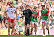 11 September 2021; Lee Keegan of Mayo, right, argues with referee Joe McQuillan after he awarded a free kick to Mayo outside the square during the GAA Football All-Ireland Senior Championship Final match between Mayo and Tyrone at Croke Park in Dublin. Photo by Brendan Moran/Sportsfile