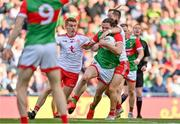 11 September 2021; Pádraig O'Hora of Mayo is tackled by Kieran McGeary of Tyrone, right, outside the square during the GAA Football All-Ireland Senior Championship Final match between Mayo and Tyrone at Croke Park in Dublin. Photo by Brendan Moran/Sportsfile