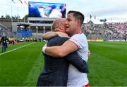 11 September 2021; Kieran McGeary of Tyrone celebrates with former Tyrone captain and Sky Sports GAA pundit Peter Canavan after the GAA Football All-Ireland Senior Championship Final match between Mayo and Tyrone at Croke Park in Dublin. Photo by Brendan Moran/Sportsfile