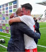 11 September 2021; Darragh Canavan of Tyrone celebrates with his father, former Tyrone captain and Sky Sports GAA pundit Peter Canavan, after the GAA Football All-Ireland Senior Championship Final match between Mayo and Tyrone at Croke Park in Dublin. Photo by Brendan Moran/Sportsfile