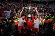 11 September 2021; Pádraig Hampsey, left, and Frank Burns of Tyrone celebrate with Patrick Trainor and the Sam Maguire Cup following the GAA Football All-Ireland Senior Championship Final match between Mayo and Tyrone at Croke Park in Dublin. Photo by Stephen McCarthy/Sportsfile