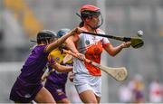 12 September 2021; Bernie Murray of Armagh in action against Aoife Dunne of Wexford during the All-Ireland Premier Junior Camogie Championship Final match between Armagh and Wexford at Croke Park in Dublin. Photo by Ben McShane/Sportsfile