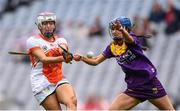 12 September 2021; Eimear Smyth of Armagh scores her side's first goal despite the attention of Clodagh Jackman of Wexford during the All-Ireland Premier Junior Camogie Championship Final match between Armagh and Wexford at Croke Park in Dublin. Photo by Ben McShane/Sportsfile