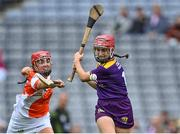 12 September 2021; Ciara Banville of Wexford in action against Leanne Donnelly of Armagh during the All-Ireland Premier Junior Camogie Championship Final match between Armagh and Wexford at Croke Park in Dublin. Photo by Piaras Ó Mídheach/Sportsfile