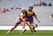 12 September 2021; Eimear Smyth of Armagh in action against Clodagh Jackman of Wexford during the All-Ireland Premier Junior Camogie Championship Final match between Armagh and Wexford at Croke Park in Dublin. Photo by Ben McShane/Sportsfile