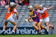 12 September 2021; Emma Tomkins of Wexford in action against Armagh players, from left, Stephanie Curry, Aislinn Harvey and Michelle McArdle of Armagh during the All-Ireland Premier Junior Camogie Championship Final match between Armagh and Wexford at Croke Park in Dublin. Photo by Piaras Ó Mídheach/Sportsfile