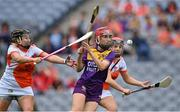 12 September 2021; Ciara Banville of Wexford in action against Gráinne McWilliams, left, and Nicola Woods of Armagh during the All-Ireland Premier Junior Camogie Championship Final match between Armagh and Wexford at Croke Park in Dublin. Photo by Piaras Ó Mídheach/Sportsfile
