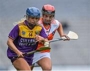 12 September 2021; Emma Codd of Wexford in action against Nicola Woods of Armagh during the All-Ireland Premier Junior Camogie Championship Final match between Armagh and Wexford at Croke Park in Dublin. Photo by Piaras Ó Mídheach/Sportsfile