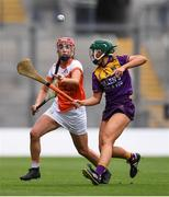 12 September 2021; Leanne Donnelly of Armagh in action against Roisin Cooney of Wexford during the All-Ireland Premier Junior Camogie Championship Final match between Armagh and Wexford at Croke Park in Dublin. Photo by Ben McShane/Sportsfile