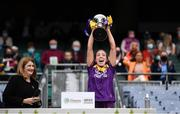 12 September 2021; Ciara Donohoe of Wexford lifts The Kathleen Mills Cup after the All-Ireland Premier Junior Camogie Championship Final match between Armagh and Wexford at Croke Park in Dublin. Photo by Ben McShane/Sportsfile