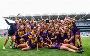 12 September 2021; Wexford players celebrate with The Kathleen Mills Cup after the All-Ireland Premier Junior Camogie Championship Final match between Armagh and Wexford at Croke Park in Dublin. Photo by Ben McShane/Sportsfile