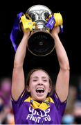 12 September 2021; Wexford captain Ciara Donohoe lifts the Kathleen Mills Cup after All-Ireland Premier Junior Camogie Championship Final match between Armagh and Wexford at Croke Park in Dublin. Photo by Piaras Ó Mídheach/Sportsfile
