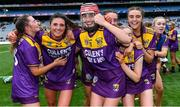 12 September 2021; Wexford players, including Ciara Banville, 11, celebrate after their side's victory in the All-Ireland Premier Junior Camogie Championship Final match between Armagh and Wexford at Croke Park in Dublin. Photo by Piaras Ó Mídheach/Sportsfile