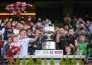 11 September 2021; Tyrone's Peter Harte, holding daughter Ava, and Niall Morgan, holding son Criostai, lift the Sam Maguire Cup following the GAA Football All-Ireland Senior Championship Final match between Mayo and Tyrone at Croke Park in Dublin. Photo by Stephen McCarthy/Sportsfile