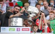 11 September 2021; Tyrone selector Joe McMahon and family celebrate with Sam Maguire Cup following the GAA Football All-Ireland Senior Championship Final match between Mayo and Tyrone at Croke Park in Dublin. Photo by Stephen McCarthy/Sportsfile