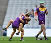 12 September 2021; Wexford players Aoife McCrea, 21, Aoife Dunne, behind, and Lara O'Shea, right, celebrate after their side's victory in the All-Ireland Premier Junior Camogie Championship Final match between Armagh and Wexford at Croke Park in Dublin. Photo by Piaras Ó Mídheach/Sportsfile