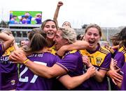 12 September 2021; Aisling Halligan, centre, celebrates with her Wexford team-mates, from left, Sarah Figgis, Chloe Cashe and goalkeeper Lara O'Shea after the All-Ireland Premier Junior Camogie Championship Final match between Armagh and Wexford at Croke Park in Dublin. Photo by Ben McShane/Sportsfile