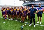 12 September 2021; Wexford manager Alan Brennan with his players, after their victory in the All-Ireland Premier Junior Camogie Championship Final match between Armagh and Wexford at Croke Park in Dublin. Photo by Ben McShane/Sportsfile