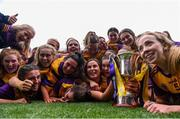 12 September 2021; Wexford players celebrate with the Kathleen Mills cup after their victory in the All-Ireland Premier Junior Camogie Championship Final match between Armagh and Wexford at Croke Park in Dublin. Photo by Ben McShane/Sportsfile