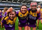 12 September 2021; Wexford players, from left, Emma Tomkins, Muireann Fitzpatrick, and Ciara Banville celebrate their side's victory in the All-Ireland Premier Junior Camogie Championship Final match between Armagh and Wexford at Croke Park in Dublin. Photo by Piaras Ó Mídheach/Sportsfile