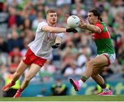 11 September 2021; Cathal McShane of Tyrone in action against Oisín Mullin of Mayo during the GAA Football All-Ireland Senior Championship Final match between Mayo and Tyrone at Croke Park in Dublin. Photo by Stephen McCarthy/Sportsfile