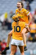 12 September 2021; Antrim players Aine Magill, 12, and Maeve Kelly celebrate after their side's victory in the All-Ireland Intermediate Camogie Championship Final match between Antrim and Kilkenny at Croke Park in Dublin. Photo by Piaras Ó Mídheach/Sportsfile
