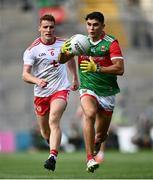 11 September 2021; Tommy Conroy of Mayo in action against Peter Harte of Tyrone during the GAA Football All-Ireland Senior Championship Final match between Mayo and Tyrone at Croke Park in Dublin. Photo by David Fitzgerald/Sportsfile