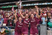 12 September 2021; Galway players, from left, Aoife Donoghue, Niamh Hannify and Catriona Cormican celebrate with The O'Duffy Cup and the supporters after their victory in the All-Ireland Senior Camogie Championship Final match between Cork and Galway at Croke Park in Dublin. Photo by Ben McShane/Sportsfile