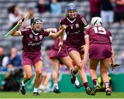 12 September 2021; Aoife Donoghue of Galway, 12, celebrates with team-mates Niamh Hannify, 8, and Ailish O'Reilly celebrate after their side's victory in the All-Ireland Senior Camogie Championship Final match between Cork and Galway at Croke Park in Dublin. Photo by Piaras Ó Mídheach/Sportsfile