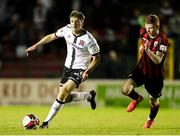 11 September 2021; Mark Hanratty of Dundalk in action against Darragh Nugent of Longford Town during the SSE Airtricity League Premier Division match between Longford Town and Dundalk at Bishopsgate in Longford. Photo by Michael P Ryan/Sportsfile